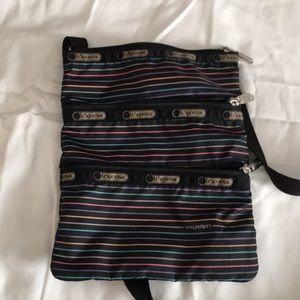 Lesportsac three pocket crossbody nylon bag.
